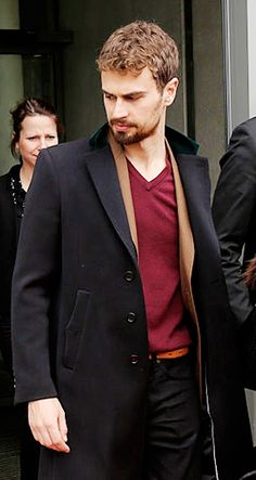 Theo in a red shirt and a trenchcoat....i think im getting lightheaded