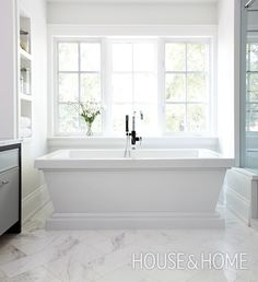 It's the clean-lined, yet still detailed, shape of this bath that makes it so interesting. While its base skews traditional, the square-ness keeps it modern. | Photographer:  Angus Fergusson  Designer:  Erin Feasby and Cindy Bleeks