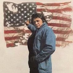 Johnny Cash - We raise her up every morning and we bring her down slow every night. We don't let her touch the ground, and we fold her up right. On second thought I do like to brag 'cause I'm mighty proud of that Ragged Old Flag""