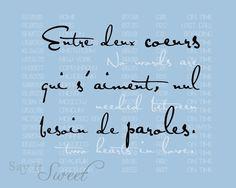 Entre deux coeurs qui s'aiment, nul besoin de paroles. No words are needed between two hearts in love.