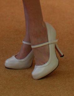Dolly Couture's White Patent Leather Mary Jane Heels.  LOVE they just need some bows haha