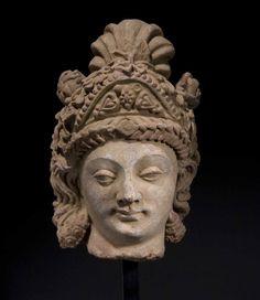 2012 Catalogue no. 4 LARGE TERRACOTTA HEAD OF A BODHISATTVA GANDHARA, HADDA STYLE 4TH - 5TH CENTURY AD H. 35 CMS, 13 ¾ INS