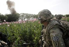The 82nd in Afghanistan -- A U.S. Army Explosive Ordnance Disposal Technician from 5-20 infantry Regiment attached to 82nd Airborne looks at an intentional detonation of an explosive device in Zharay district in Kandahar province, April 26, 2012.   REUTERS/Baz Ratner