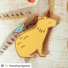 This pin by #Repost @thewallopingjackal is so darling!!! ・・・ Capybara & Bird Friend pin now in the shop! 💫💪 #capybara #enamelpin #pingame #lapelpins #pingram #pinstagram
