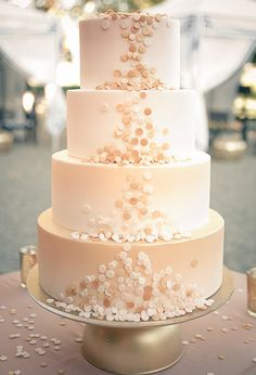 The fun details on this four-layered, blush-colored wedding cake are pretty exceptional.
