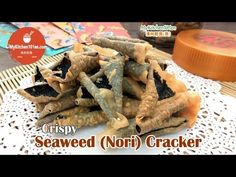 This seaweed cracker (or nori cracker) is made from yaki sushi nori (roasted seaweed) and spring roll pastry. The making process is very simple, just stick together these 2 ingredients with some eg… Crispy Seaweed, Seaweed Wrap, New Year's Snacks, Party Snacks, Spring Roll Pastry, Boyfriend Food, Roll Cookies, Spring Rolls, Japanese Food