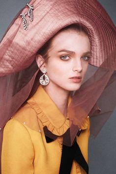 Haute Halloween: Gucci jacket, $2,100, gucci.com; Van Cleef & Arpels earrings (on ear and hat), prices upon request, 877-VAN-CLEEF; Eric Javits hat, $2,000.   - HarpersBAZAAR.com