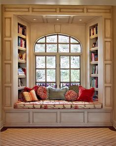 Window seat with books and pillows. Love.