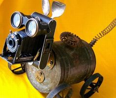 Robot BowWow –  finally a dog you don't have to walk or clean up after!   Robot dog from recycled materials