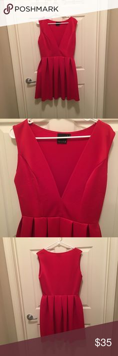 """ASOS tall plunging v neck dress Great used condition. There are """"stretch marks"""" on the front of the dress- pictured above. But I think it's just because of the fabric. You can't tell unless you're looking for it. ASOS Dresses"""