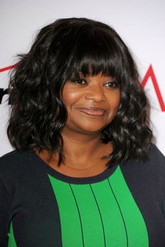 """""""Don't be afraid to mix different textures,"""" says Hill of Octavia's loose curls and bombshell bangs. """"This look works because she's kept the root area a little smoother to blend with her bangs.""""   - Redbook.com"""
