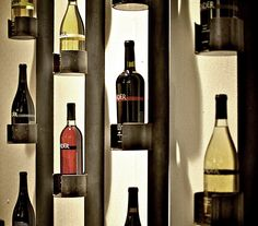 An inventive wine/bottle storage system created with Steel Flat Bar and Pipe. With the thin profile and cantilevered bottle storage this design creates a dramatic three dimensional wall treatment.