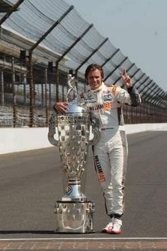 RIP Lion Heart....Dan Wheldon posed with the Borg-Warner Trophy on the Indianapolis Motor Speedway track the day after winning the 2011 Indianapolis 500.