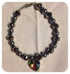Silver Heart Bracelet by uniquelydolledup on Etsy https://www.etsy.com/listing/492461361/silver-heart-bracelet
