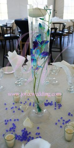 #blue #orchid #submerge #floating #candle #centerpiece #wedding #reception  This is a #unique #way of having a #centerpiece. #Blue #orchid #submerged in a #vase with a #floating #candle is #definitely a #different #approach of #elegance.