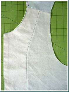 Other Finished Schoolhouse Tunics... Not mine! Sewing the Placket to the Bodice, Stitches show on the front!