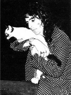Alice Cooper with a cat - love it to death!