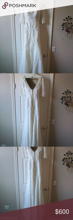 Gorgeous Embroidered Ivory Gown This dress is a dream! It's absolutely stunning and I got so many compliments. The lace on the bodice is embroidered with additional flowers in the same ivory color (see photos). Also unique with this dress are the elbow-length lace sleeves and deep v back. The dress has been cleaned and there are no stains on it. David's Bridal Dresses Wedding