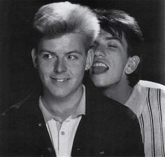 Andy Rourke and Mike Joyce from The Smiths having a lot of fun during a photo session for the: Record Mirror (September 8, 1984).