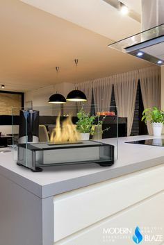 This minimalist tabletop fireplace works with any decor. Decor, Tabletop Fireplaces, Black Table, Table, Kitchen Fireplace, Ethanol Fireplace, Table Top, Traditional Kitchen, Wood Burning Fireplace
