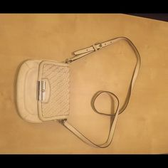 1 day sale Coach white crossbody bag In a ok condition used white coach authentic crossbody bag. It is white, so gets dirty from jeans easily. Inside has some dirt too as u see the blue fabric, normal tear and wear. As not used ofter. Coach Bags Crossbody Bags