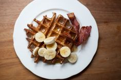 I like mine with very crispy streaky bacon, some banana or strawberries and lashings of maple syrup. I've also recently discovered the purer pleasure of a bit of salted butter melted over the top with some maple syrup. What do you like with your waffles? Crepes And Waffles, No Bake Desserts, Dessert Recipes, Hoe Cakes, Dessert Blog, Delicious Breakfast Recipes, Recipe Mix, Maple Syrup, Waffles