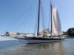 wooden sailboat | ... view of this very large sail boat dropping sails in the harbor