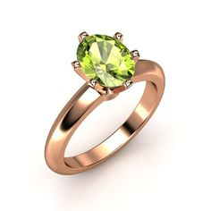 The Oval-Cut Lisa Ring customized in peridot and rose gold. Our newest arrival!