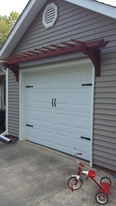 Magnetic garage door hardware. Carriage Door with Pergola. Easy garage door makeover for a weekend project and instant curb appeal.