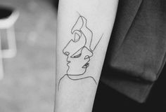 10 prachtige één-lijn-tatoeages die bewijzen dat meer niet altijd beter is - Spike