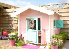 lovely play house... probably would go for pink because would wanting something neutral... however this looks beautiful...