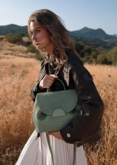"Undeniably feminine for its sensual curves, ""Number One"" is Polène's signature handbag. Designed as a day bag, you'll love its elegant yet easy-going style. Polene Paris, S Signature, Day Bag, Outdoor Photography, Number One, Calf Leather, Saddle Bags, Fashion Backpack, Calves"