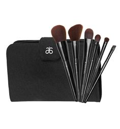 Cosmetics Brush Set US #7098 - Arbonne -- Have a brush with greatness. Our specially designed brushes give you all the tools to create the perfect beauty look. You'll love their super-soft feel and natural wood handles - plus they come in a chic canvas case with a pocket for makup extras. Six brushes: Liquid Foundation, Powder, All Over Eye, Shading, Slant and Cheek.