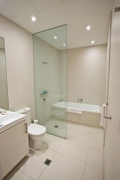 Wet room - good solution to fit separate bath & shower into a small bathroom