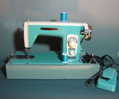 Vintage Brother sewing machine in turquoise--I'm half tempted to get it just because of the color.