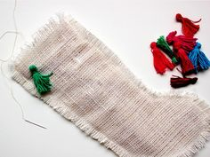 How to Make a Burlap Christmas Stocking: Pull the end threads of burlap to fringe the edges. Use your fingers to fluff up the fringe. From DIYnetwork.com