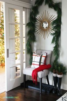 Love this festive Christmas entryway and home tour with red and plaid accents via Life On Virginia Street