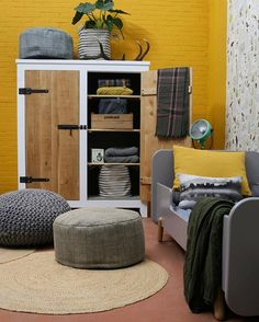 Love the yellow wall Garage Renovation, Couch Cushions, Yellow Walls, Rocking Chair, Ottoman, Armchair, Entryway, Bedroom, Storage