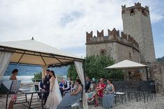 A romantic wedding on Lake Garda at Castello Scaligero is what we present in this article. If you dream of a truly unique location rich in history, the city of Malcesine Civil Ceremony, Outdoor Ceremony, Wedding Ceremony, Lake Garda Wedding, Wedding Castle, Italian Lakes, Medieval Wedding, Destination Weddings, Amazing Destinations