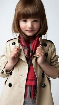 How adorable is this look, a classic trench (Burberry) layered with pops of color, super cute bangs to bring attention to the eyes