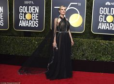 Shine: Diane Kruger made an eye catching arrival in her nude and black immaculate gown by ...