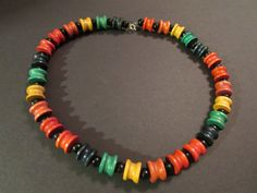 This vintage wood necklace has bright multicolor carved wood beads with black round gloss wood beads in-between each of the multicolor.   This unique vintage necklace will ... #4rloveofoldandnew