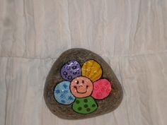 Happy flower painted rock