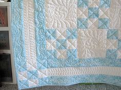 I love how the quilting makes this quilt look harder to make...great for a baby boy!