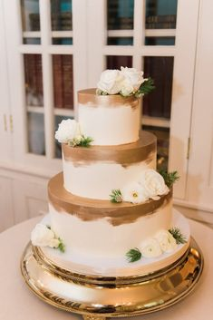 Wintery Glenview Mansion Maryland Wedding - United With Love   Joy Michelle Photography   Three Tiered Wedding Cake with Brushed Gold and White Flower Accents   Gold Cake Design   Winter Wedding Cake