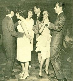 Today (February 27th) is Elizabeth Taylor's birthday! Here she is dancing with Eddie Fisher while Natalie and Audrey Hepburn dance with their husbands. #blackandwhite