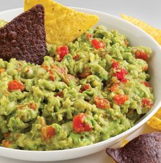 We found a pretty great shortcut for adding extra flavor to guac. Rockin' Guacamole's got a can of Ro-Tel stirred in. How genius is that? Add a little extra onion and lime and you've got it made.