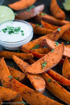 Skip the greasy fries and enjoy these scrumptious baked Sweet Potato Wedges with Honey Lime Dip.