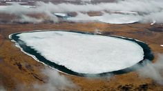 Long-dormant bacteria and viruses, trapped in ice and permafrost for centuries, are reviving as Earth's climate warms