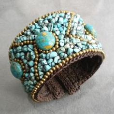 This cuff features a blue reconstructed turquoise oval design with the stones and brass sewn on cotton wax rope. Handmade in Thailand by artisan, Jeab, this bracelet can adjust to wrists of many sizes.